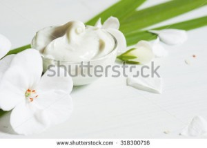 stock-photo-cosmetic-cream-with-white-flowers-on-bright-wooden-table-318300716