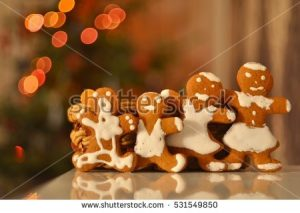 stock-photo-lovely-ginger-cookies-family-with-blurred-background-of-new-year-tree-531549850